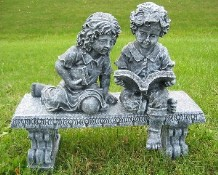 Children Reading together on Bench